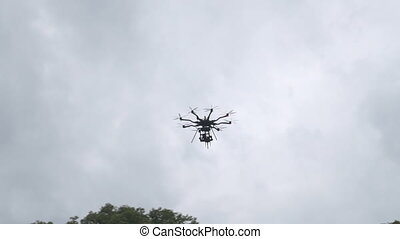 Big commercial television drone flying in the sky.