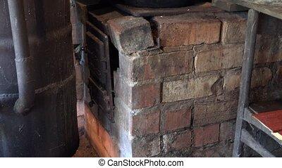 big copper vat boil with vodka alcohol in rural boxroom. -...