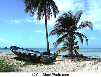 Big Corn Island Nicaragua fishing panga boat beach with palm coconut trees Caribbean Sea Central America