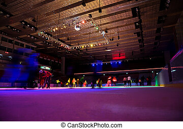 big covered skating rink with multi-coloured illumination in...