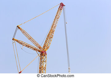 big crane on blue sky background.