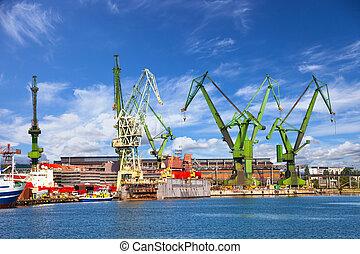 Big cranes and dock at the shipyard.