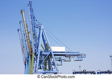 big blue cranes at the dcosk for laoding container ships