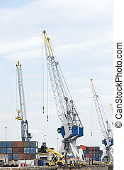 big cranes for transport of containeers in dutch harbor
