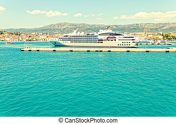 Big cruise liner moored in the harbor of Split city -...