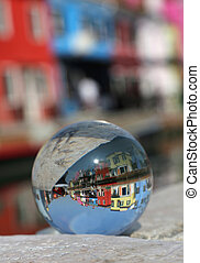 crystal ball with the colored houses of the island of Burano...
