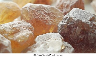 Big crystals of brown sugar, macro dolly shot