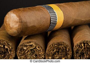 Big Cuban Cigars - A stack of exclusive Cuban Cigars on...