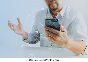 Big data analytics with business intelligence (BI) concept. businessman using mobile phone and laptop computer on white desk
