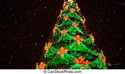 Big decorated christmas tree outdoors.