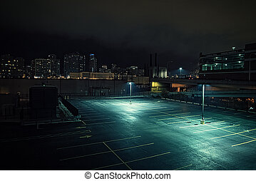 Big deserted urban city parking lot and garage at night in Chicago