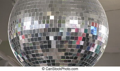 Big disco ball rotating %u2013 reflecting different colours. Shot with Canon XH-A1s.