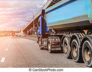 dump truck goes in the evening on highway