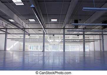 big empty industrial hall with headlights on the ceiling