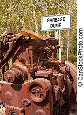 "Big engine block and sign ""Garbage Dump"""