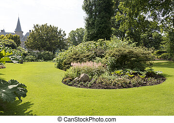 big english garden with green plants and grass