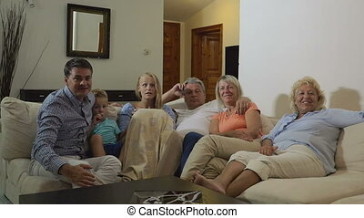 Big excited family watching sport game on TV