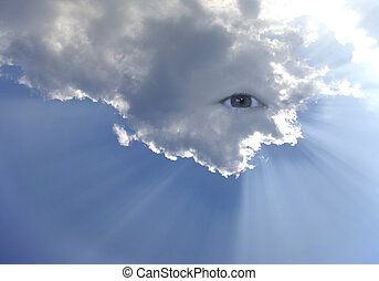 Big eye in the sky with lot of rays of light through clouds