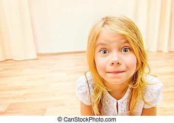 Portrait of a cute joyful girl at home.