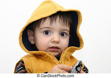 Big Eyes - Toddler boy making big eyes and playing with a...