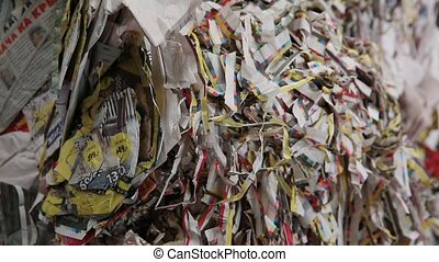 Big Factory For Recycling Paper and Carboard. Processing of secondary resources. Paper recycling. Waste paper. Garbage truck unloads the waste paper at the garbage recycling plant. Close-up shot.