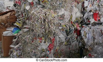 Waste paper. Processing of secondary resources. Paper recycling. Large enterprise. Large bales of waste paper are compressed and ready for processing. Environment protection concept.