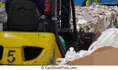 Big Factory For Recycling Paper and Carboard. - Loader sorts...
