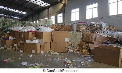 Big Factory For Recycling Paper and Carboard. - Pile of...
