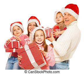 Big family 3 kids with many Christmas presents