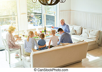 Big Family at Dinner Table