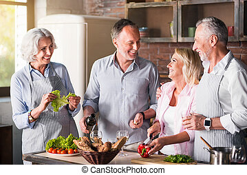Big family cooking in the kitchen together