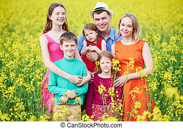 Big family in summer field outdoors.