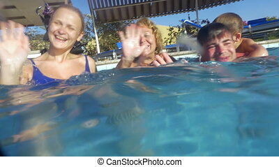 Big Family in Swimming Pool - Slow motion shot of a big...