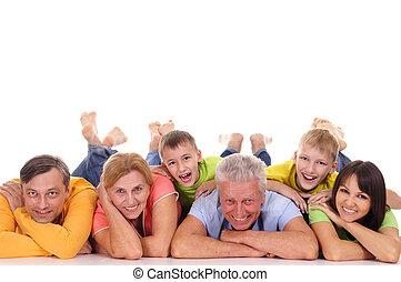 big family lying - big family of a six lying on white