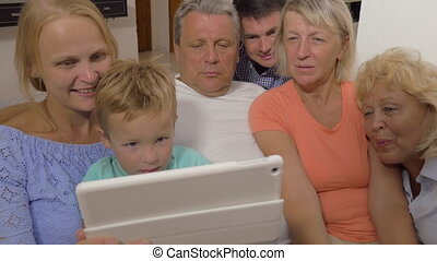 Big family watching something on touch pad