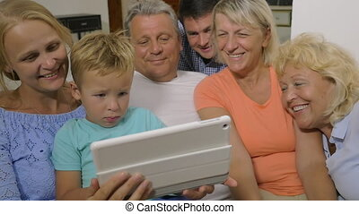 Big family watching video on touch pad - Slow motion of...