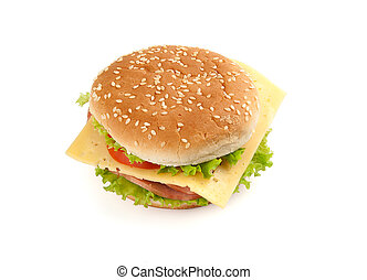 Big fast food sandwich with lettuce, ham, cheese and tomato