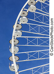 big ferris wheel against a blue sky in Marseilles, France