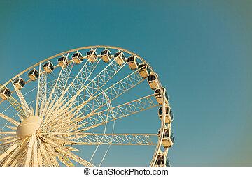 Big ferris wheel on blue sky background