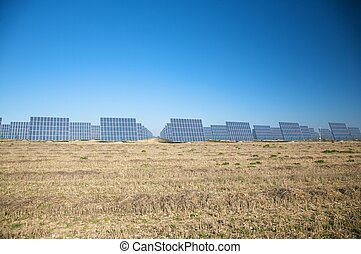 big field of solar panels