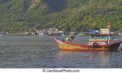 Big fisherman boats coming out of the port in Asia. Overfishing concept.