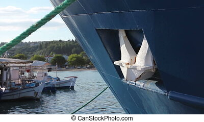 Big fishing boat is tied up with rope for the dock, marina -...