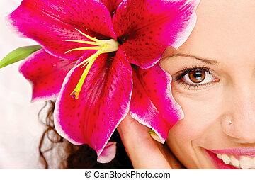 Big flower in woman's hair