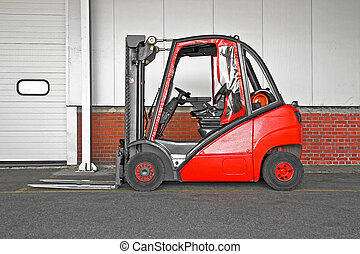 Big forklifter - Big red fork lifter truck in storehouse