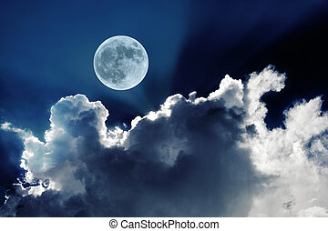 Big full moon in night sky with beautiful white clouds