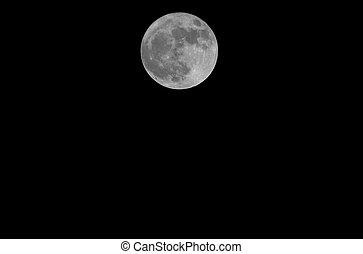big full moon in the dark sky