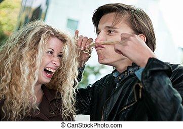 Big fun - couple playing with hair