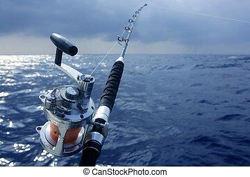 Big game obat fishing in deep sea on boat