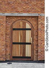 Big gate wood door on brick wall