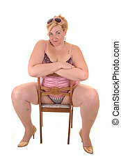 Big girl. - An big overweight woman in pink lingerie sitting...